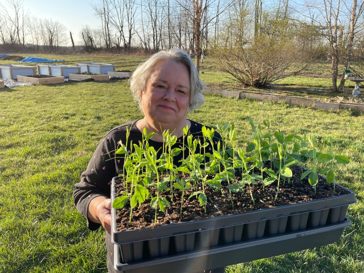 MaryAnne holding sweet pea plants